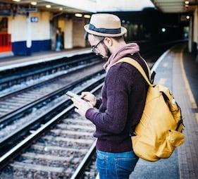 station man with phone.jpeg